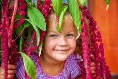 Sorridere piacevole della bambina Fotografia Stock