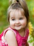Sorridere piacevole della bambina Immagini Stock