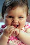 Sorridere sveglio della neonata Immagini Stock