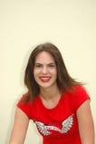 Sorridere teenager nel colore rosso Fotografia Stock