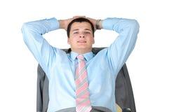 Sorrindo, homem de negócios considerável. Assento na cadeira. Fotografia de Stock Royalty Free