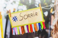 Sorrir meddelande, sorrir, hashtagsorrir arkivbild