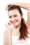 Sorrisi asiatici della donna che mostrano i denti Fotografia Stock