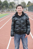 Sorrisi del giovane di Asain Fotografie Stock