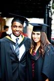 Sorrisi di graduazione Fotografia Stock