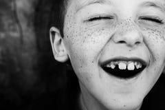 Sorrisi e freckles Fotografia Stock