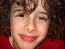Sorrisi svegli del ragazzino Immagini Stock Libere da Diritti
