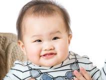 Sorriso asiatico della neonata immagini stock libere da diritti