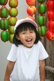 Sorriso asiatico felice della ragazza Fotografie Stock Libere da Diritti