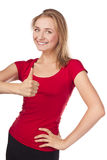 Sorriso atrativo louro no estúdio, polegares acima Fotografia de Stock Royalty Free
