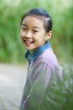 Sorriso chinês da criança Fotos de Stock Royalty Free