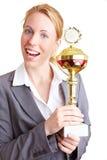 Sorriso com troféu imagem de stock royalty free