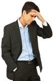 Sorriso confuso do homem de negócio Imagem de Stock