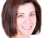 Sorriso da mulher consideravelmente nova Fotografia de Stock