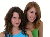 Sorriso de duas mulheres novas Imagem de Stock Royalty Free