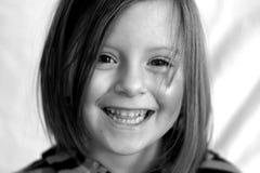 Sorriso della bambina Immagini Stock