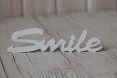 Sorriso di legno di parola Immagine Stock