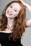 Sorriso dirigido vermelho bonito da menina Foto de Stock Royalty Free