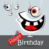 Sorriso divertente ed occhi della carta di buon compleanno Fotografie Stock