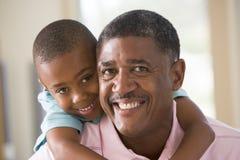 Sorriso do avô e do neto Imagens de Stock Royalty Free