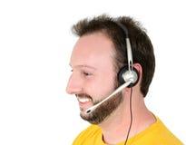 Sorriso do homem da sustentação do voluntário ou do telefone do centro da crise imagens de stock