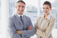 Sorriso do homem e da mulher de negócio imagens de stock