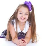Sorriso dos 6 anos bonitos da menina idosa Imagens de Stock Royalty Free