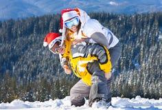 Sorriso dos esquiadores para a câmera Fotografia de Stock Royalty Free