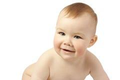 Sorriso e gioco svegli del bambino Fotografie Stock