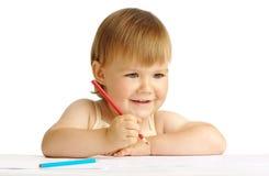 Sorriso e tração felizes da criança com pastel vermelho Imagens de Stock Royalty Free