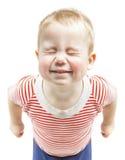 Sorriso engraçado do menino da criança e olhos fechados estreitos, ha fotografia de stock royalty free