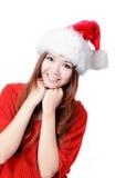 Sorriso felice della ragazza con il cappello di natale Immagini Stock
