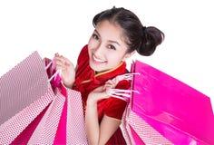 Sorriso felice ed acquisto della ragazza bella dell'Asia Fotografie Stock