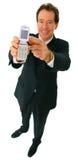 Sorriso feliz isolado do homem de negócios que mostra o telemóvel foto de stock