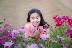 Sorriso gial asiatico Immagini Stock