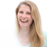 Sorriso grande brilhante e cabelo louro consideravelmente longo fotografia de stock royalty free