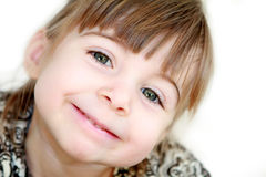 Sorriso inclinato Fotografia Stock Libera da Diritti