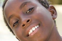 Sorriso indietro Fotografie Stock Libere da Diritti