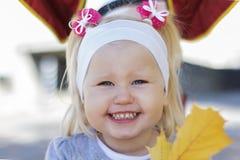 Sorriso infantile Fotografia Stock