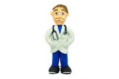 Sorriso novo do doutor do sucesso feito no plasticine fotografia de stock