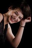 Sorriso onesto della ragazza graziosa Fotografia Stock