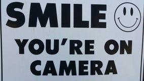 Sorriso siete sulla macchina fotografica Fotografia Stock