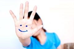 Sorriso sulla mano per il concetto felice. Fotografia Stock