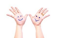 Sorriso sulla mano per il concetto felice. Fotografie Stock