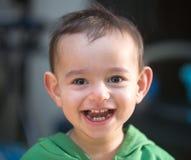 Sorriso surpreendente de uma criança Fotos de Stock