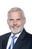 Sorriso toothy do retrato superior do homem de negócios Fotografia de Stock Royalty Free