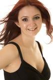 Sorriso vermelho do vestido do preto do sopro do cabelo da mulher Fotos de Stock