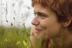 Sorrisos da mulher nova Imagens de Stock