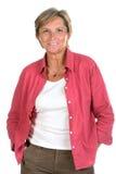 Sorrisos de meia idade da mulher foto de stock