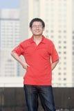 Sorrisos do homem novo de Asain Fotografia de Stock